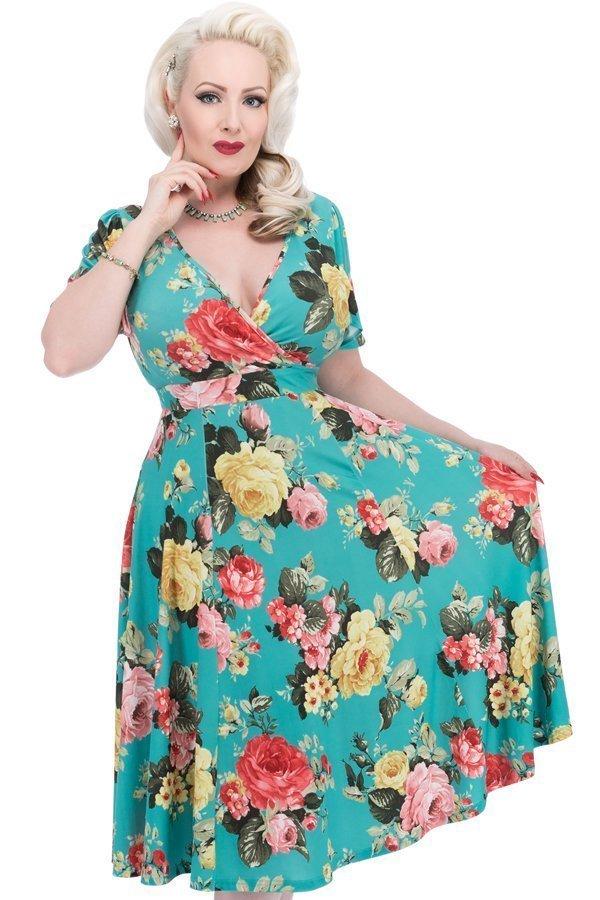 Blågrøn kjole med store roser og flagrende skørt